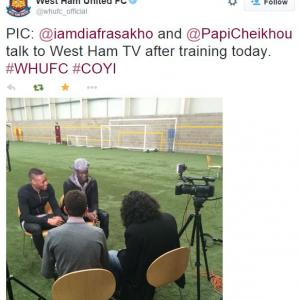 Marc Joss, French consecutive interpreter with West Ham's Cheikh Kouyaté and Diafra Sakho as seen on the official West Ham United Twitter account, football interpreter